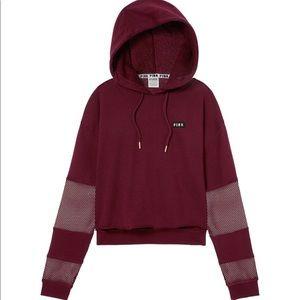 Pink Vs mesh inset crop hoodie.